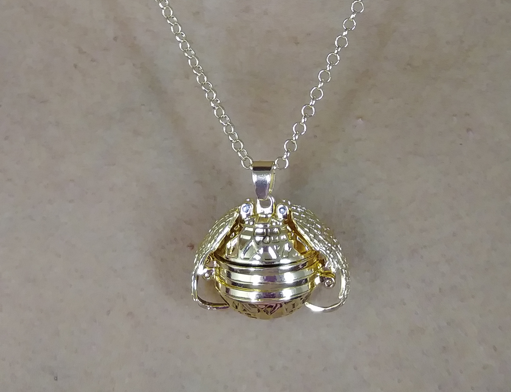 PA-119_Angels-Wings-Four-Photos-Locket_gold2.png